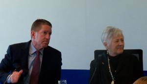 Board of Regents President Bruce Rastetter and U-I President Sally Mason listen to AIB's president.