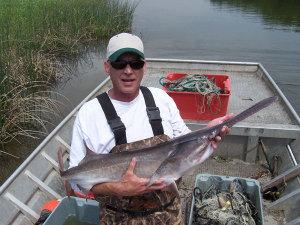 Van Sterner holding a paddlefish.