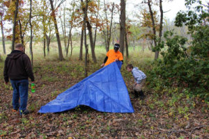 A simple shelter made from a tarp can save your life in severe weather.