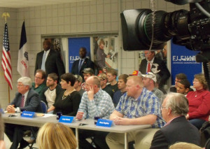 Ciommunity college, business officials and students listen to the Vice President Biden.