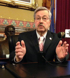 Governor Branstad talks to reporters in his formal statehouse office.