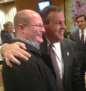 Chris Christie (right) pauses for a picture.
