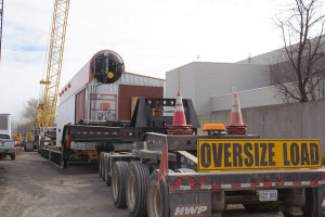 A boiler that will use natural gas to generate power at Iowa State University sits on the trailer that hauled it from the train yard in Boone to the Ames campus.