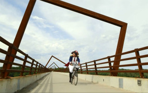 New Iowa Tourism ads feature Napoleon visiting attractions in the state like the High Trestle Bridge.