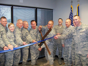Colonel Kevin Heer and General Tim Orr cut the ribbon for the new recruiting office.