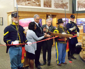 Governor Branstad helps cut the ribbon for the Civil War exhibit.