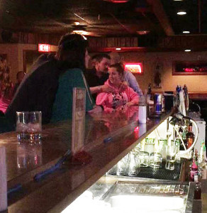 Des Moines police released this picture of the suspect. He is behind the women in pink at the bar.