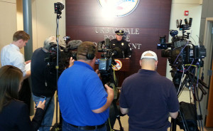 Urbandale Police Sergeant Gary Lang talks with the media.