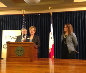 Leah Rodenberg speaks at news conference with Governor Branstad & Angela Ten Clay.
