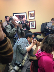 Photographers trying to get a picture of Clinton.