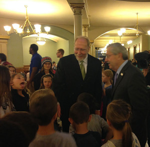Representative Dave Loebsack (left) & Gov. Terry  Branstad visit with second graders visiting statehouse Monday.