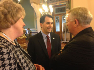 Walker speaks with State Rep. Mary Ann Hanusa & Iowa Western Community College President Dan Kinney.