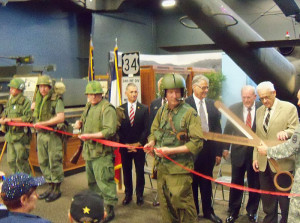 Men dressed in Vietnam era uniforms were present for the ribbon cutting.