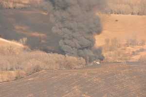 A home was destroyed in one of several grass fires near Sioux City in western Iowa Tuesday.