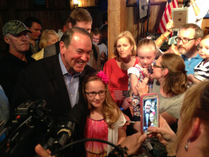 Mike Huckabee poses for pictures.