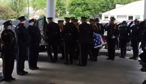 An honor guard carries the casket of Omaha Police Officer Karrie Orozco.