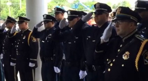 Officers salute their fallen comrade.