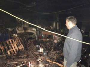 Camp Albrecht executive director Eric Veltstra looks over the damage from a fire which destroyed an estimated $100,000 worth of property.