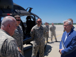 Governor Branstad gets a look at one of 4 Lakota helicopters operated by the Iowa Air Guard.