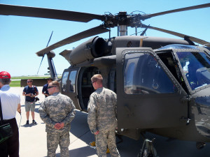 Iowa Air Guard members show off a Blackhawk helicopter.