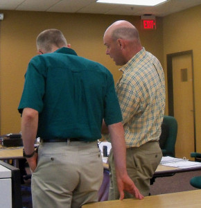 Bob Sinclair (right) discusses possible changes with Joe Griffen of the DNR.