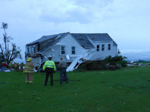 Emergency officials look over the storm damage.