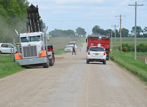 Trucks working to haul away dead birds in northwest Iowa.