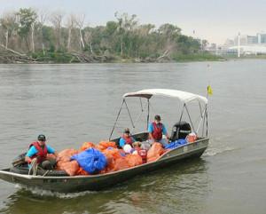 Volunteers help clean up the Missouri River.