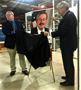 Terry Branstad and Mike Chapman (the author) unveil the book's cover.