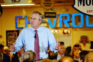 Jeb Bush speaks in Ankeny at Dennis Albaugh's car barn.