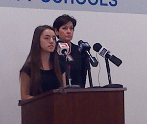 Araceli Lopez explains the program as Lt. Governor Reynolds listens.