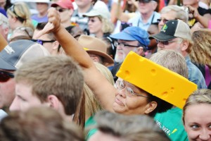 "Protestors wore yellow cheese hats and made ""thumbs down"" signs as Walker was talking."