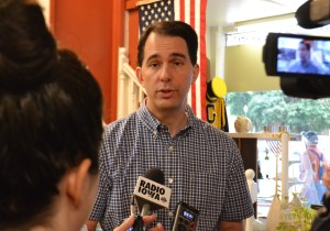 Scott Walker answers questions from reporters in Greenfield, IA.