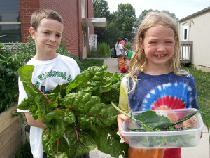 Kids from Cowless Montessori School in Des Moines with the Swiss chard they grew at school.