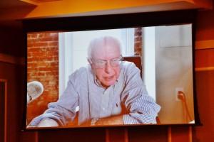 Bernie Sanders speaking at the forum via video stream.