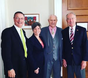 Congressman Rod Blum, Senator Joni Ernst, Max Ortner and Senator Chuck Grassley. (L-R)