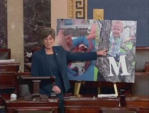 Joni Ernst on floor of U.S. Senate with picture of Micah.Pickering.