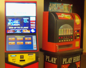 The new type touch screens on the left, could replace the older machine on the right.