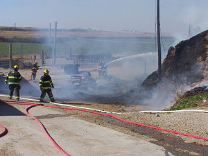 Firefighters work on a fire near Le Mars.