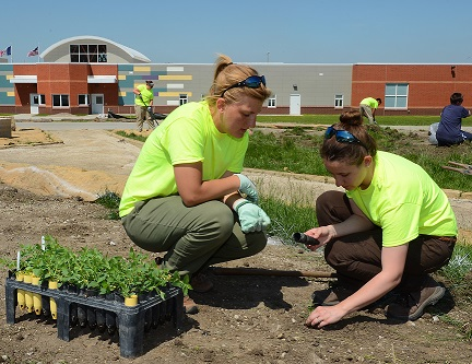 ISU students work on the grounds at the Mitchellville prison