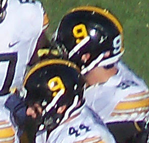Iowa players wore helmets with Tyler Sash's number 9 to honor him during this year's game with Iowa State.
