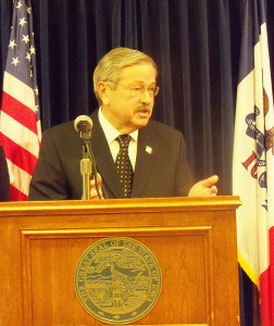 Governor Terry Branstad talks with reporters.