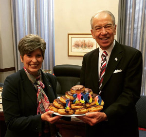 Senator Joni Ernst and Senator Grassley celebrate his milestone vote.