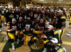 Hawkeye players celebrate their win and share of Big 10 West title. Photo from @IowaFBLive.