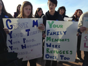 Rally outside the state capitol in support of Syrian refugees.