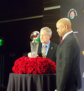 Kirk Ferentz and Brian Shaw pose in front of the Rose Bowl trophy.