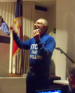 Jonas Nagram speaks at the public meeting.