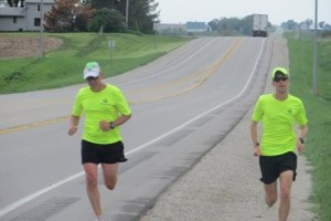 Dennis Lee (left) and Daren Schumaker near the end of a 26.2 mile run across Adams County