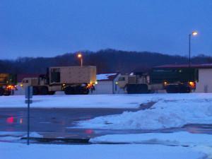 Iowa National Guard trucks returning from Missouri.