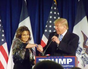 Sarah Palin and Donald Trump shake hands after her endorsement.